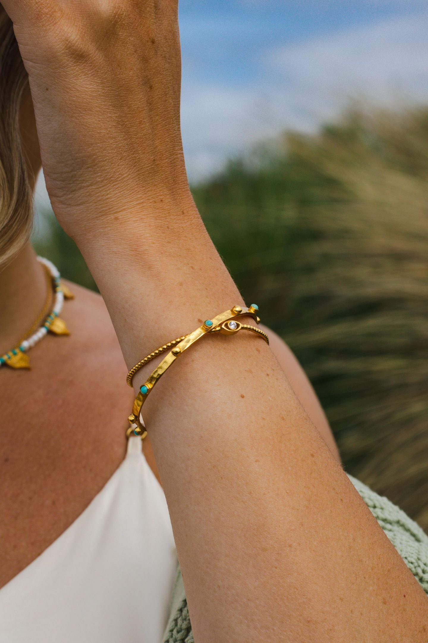 Ottoman Hands Jewellery. Tanrica Gold bangle with Turquoise Beads and Cielo Eye Bracelet white crystal